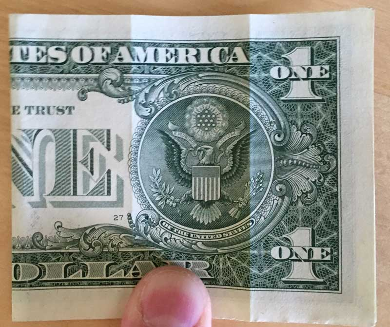 Fold the bill in half and crease