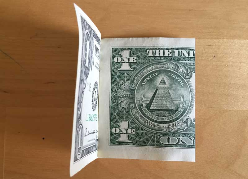 Ensure the second fold is even then crease the fold