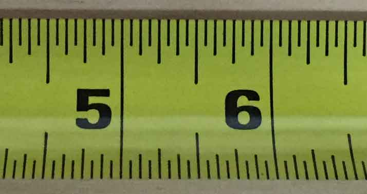 photo showing the largest markings on a tape measure representing one inch increments.