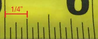 photo showing the markings in the center of the inch marking and half-inch marking representing the quarter inch markings