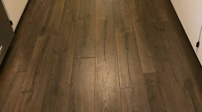 laminate flooring installed in a kitchen space