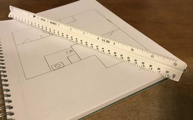 architects rule shown next to architectural blueprint drawing