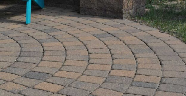 Circular patio with tan paver stones