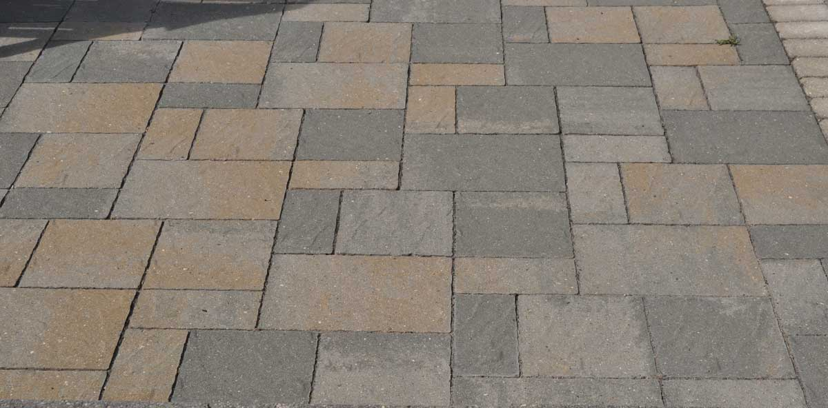 paver patio with a pattern using small and large pavers with various colors and textures