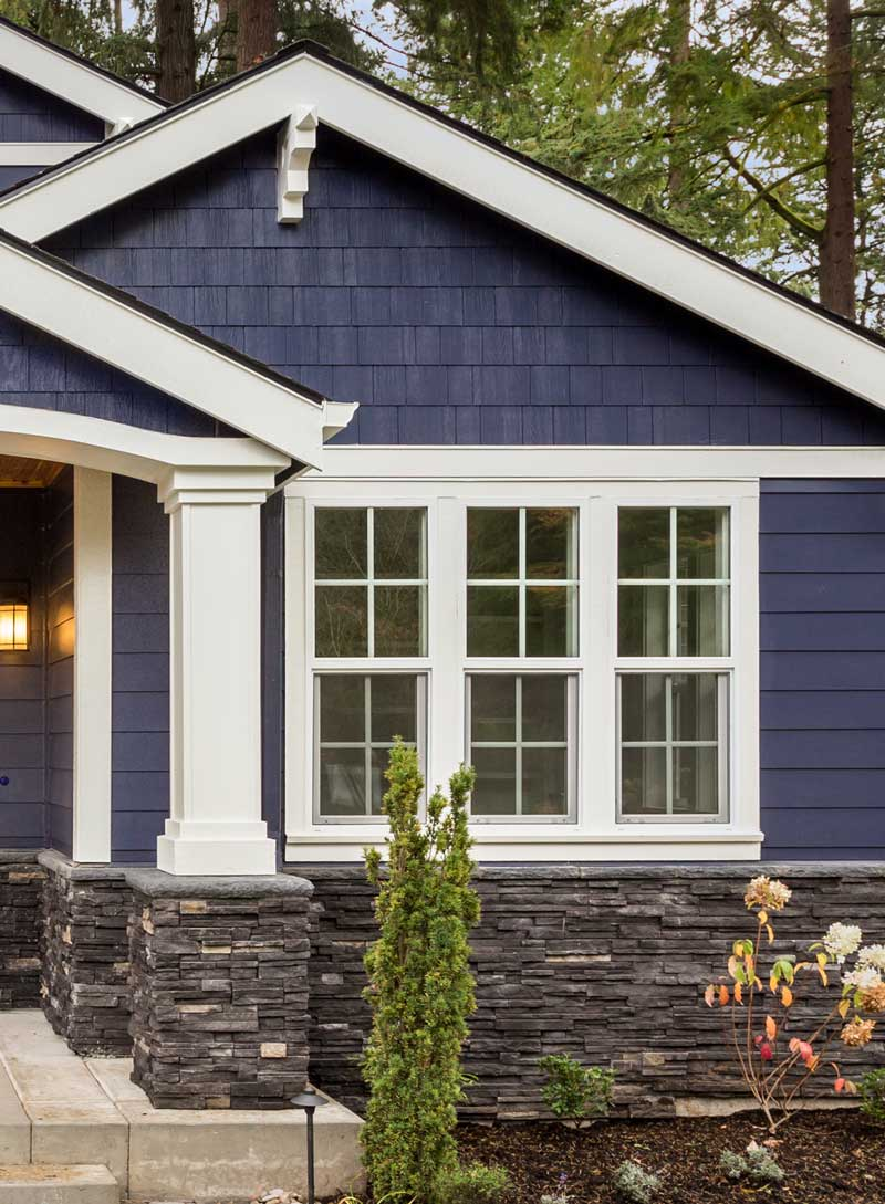 Newly installed exterior using different complimenting styles of siding