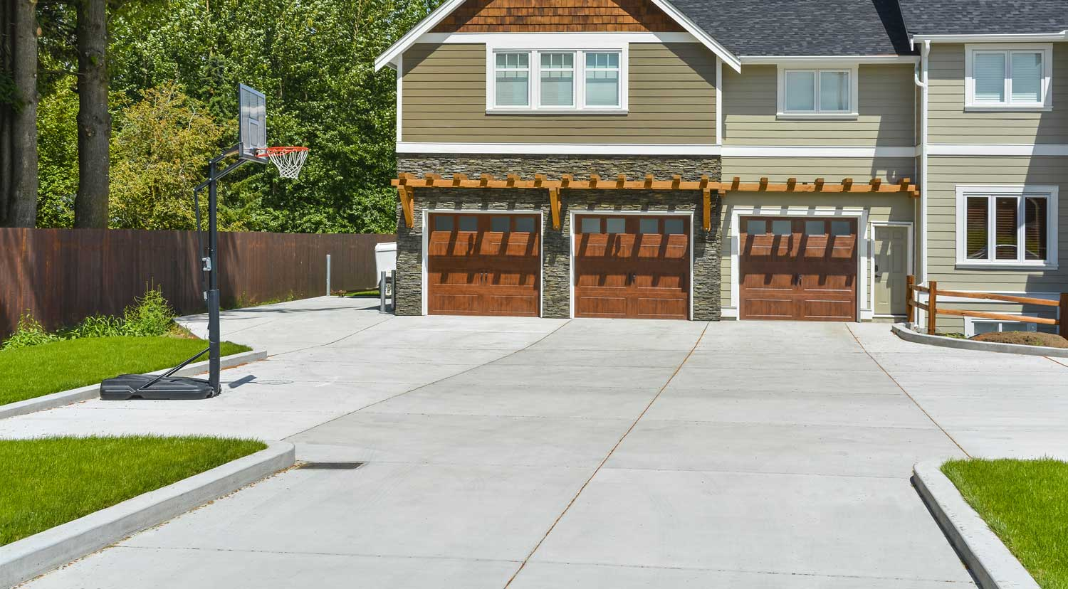 New concrete driveway in front of a home