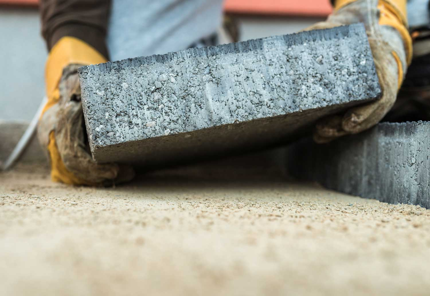 Installing a paver patio on a newly laid paver base
