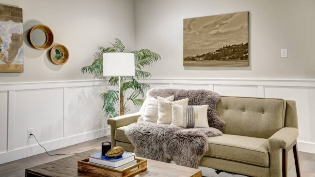 Image of raised panel wainscoting with white enamel installed on a wall