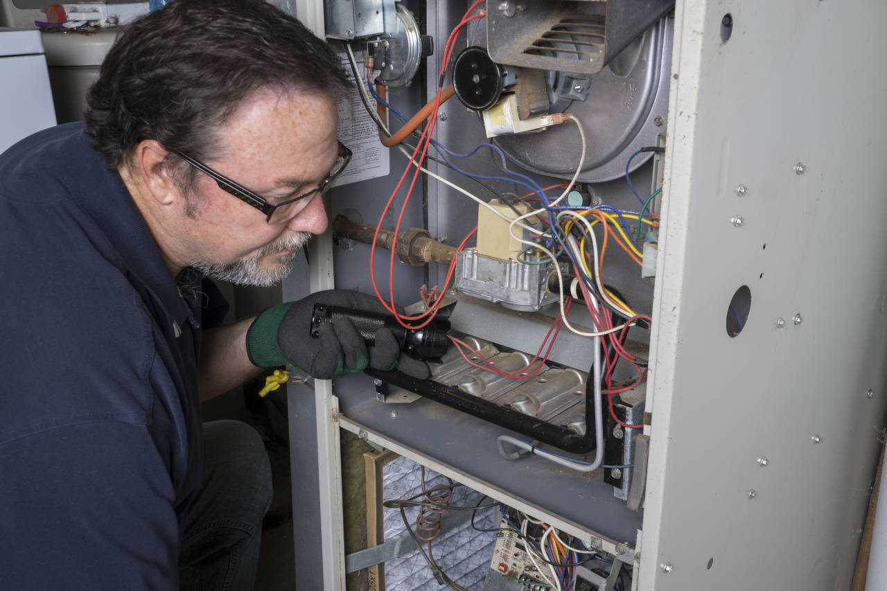 Technician repairing a natural gas furnace