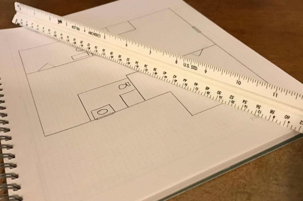 scale rule and hand-drawn blueprint of a home