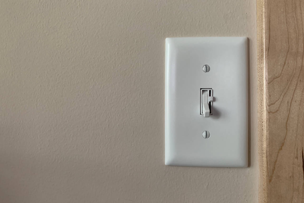white light switch with a dimmer on a wall