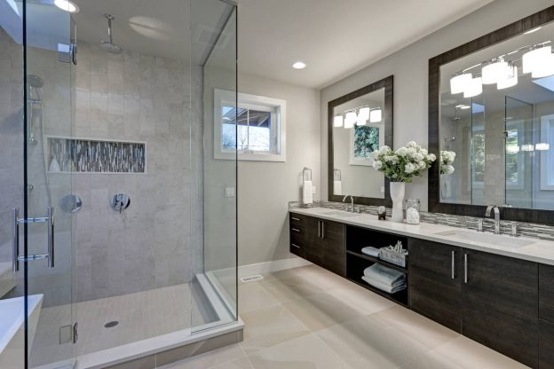 Bathroom with a shower with frameless glass surround