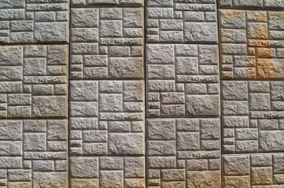 Poured concrete retaining walls can be colored and stamped to look like natural stone