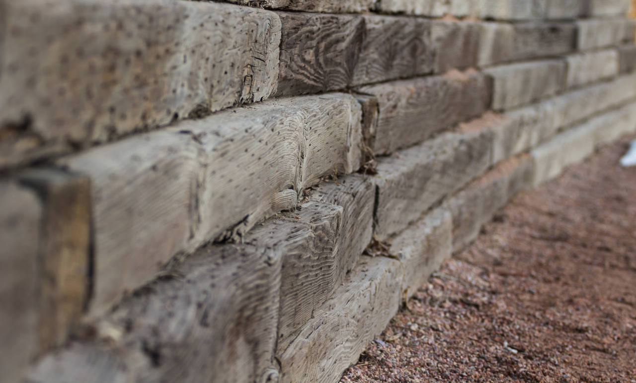 Retaining wall constructed from wood timbers