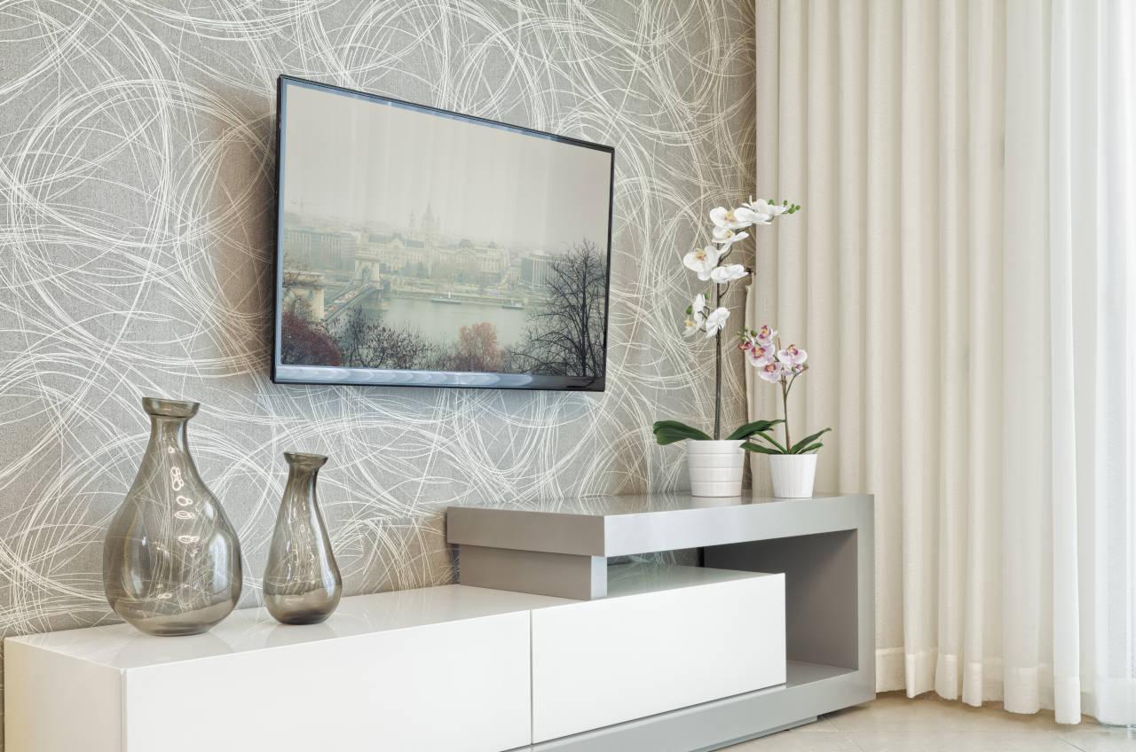 flat screen tv mounted on a tilting wall-mount bracket