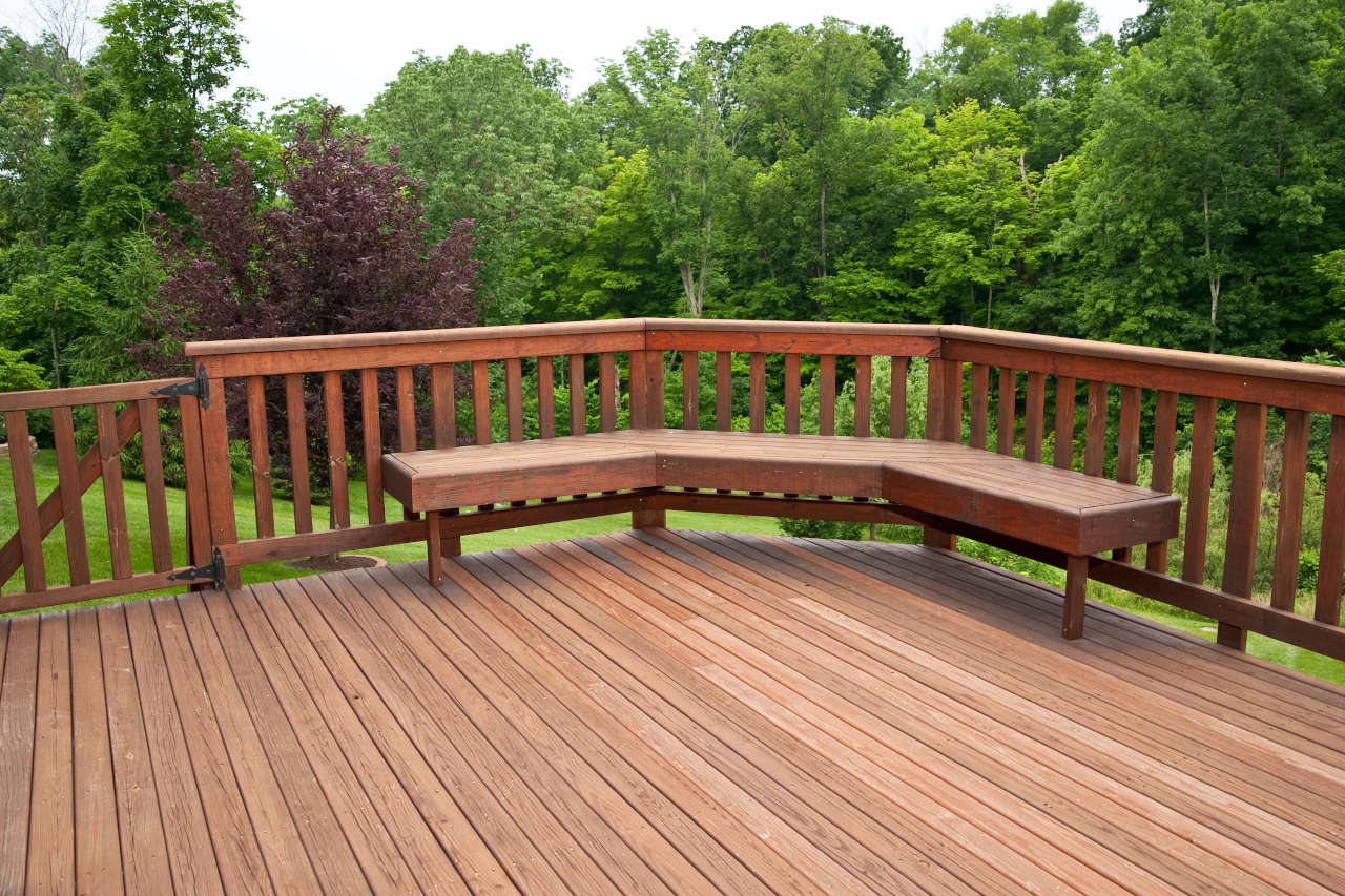 newly installed deck with redwood flooring and balusters