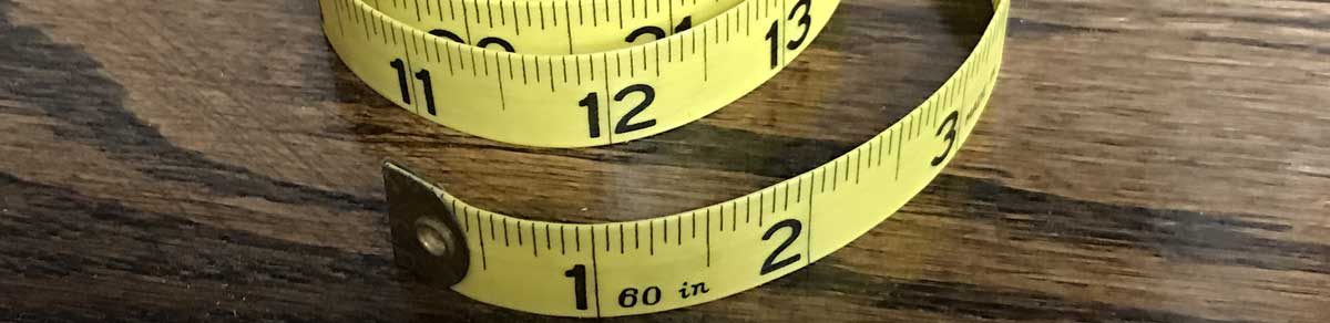 Tape measures can be used to measure units of length, and a calculator can be used to convert to another unit