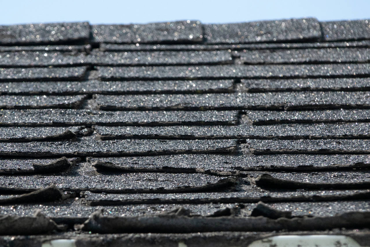 shingles on a roof that are curling