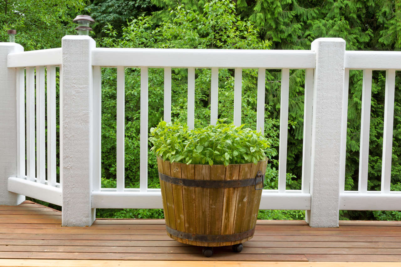 Deck railing with evenly spaced balusters