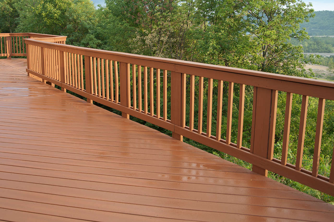Deck railing with wooden balusters