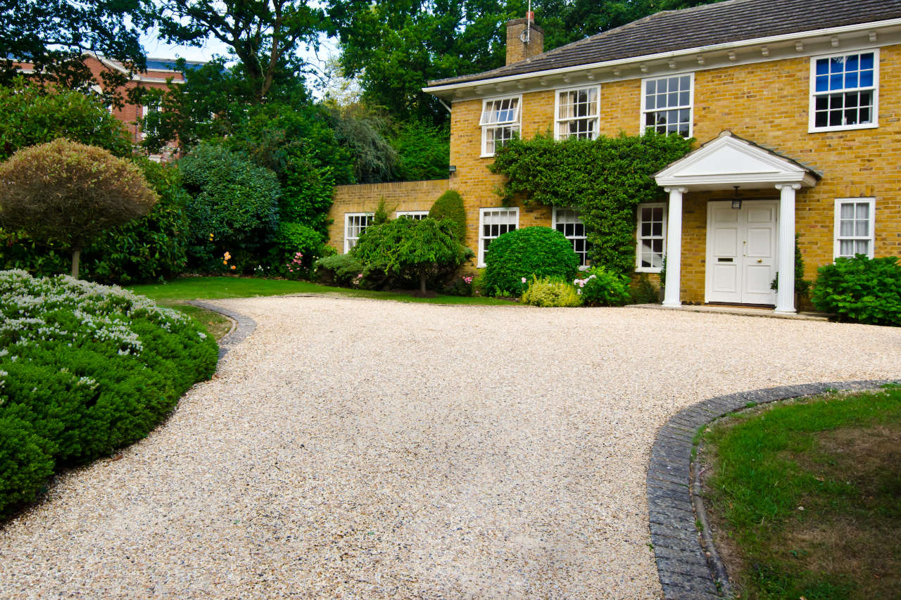 Gravel driveway consisting of a 6-8 inch bed of crushed stone