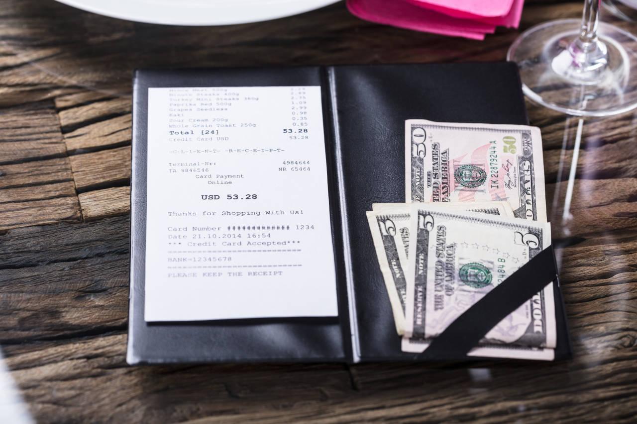 Cash tip left for a restaurant bill