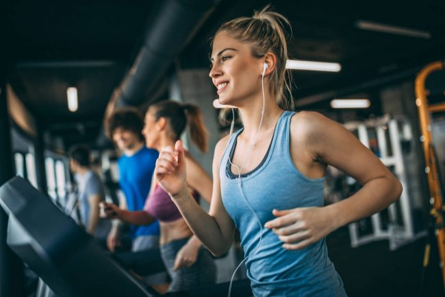 woman running on a treadmill at the gym