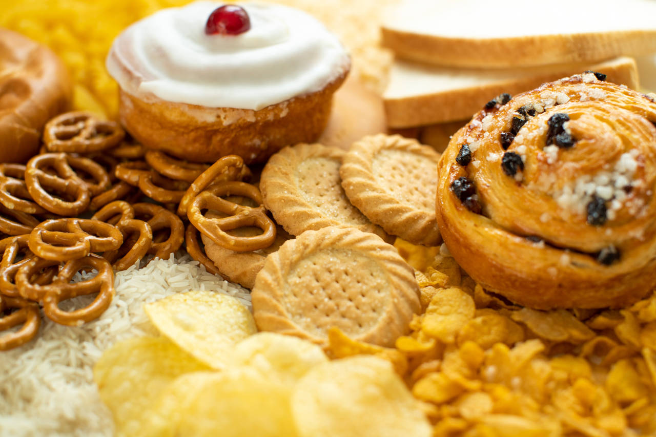 platter of foods high in simple carbohydrates, including pastries, cookies, high fructose corn syrup, and chips